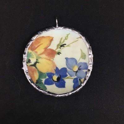 Paragon orange and blue flowers round pendant