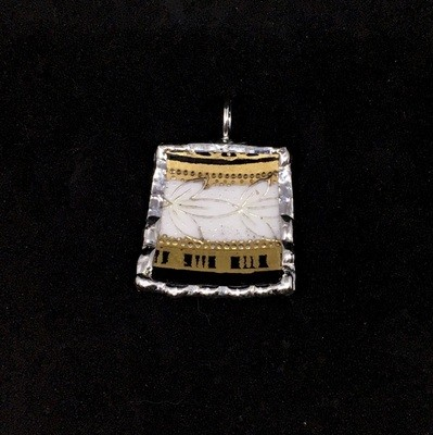 Petite square black and gold pendant