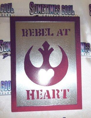 Rebel At Heart Tin Sign