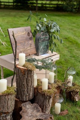 Log stack with pickling jars and chunky candles