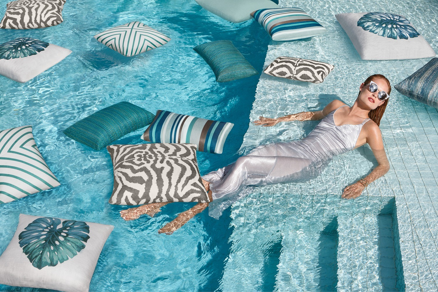 The Elaine Smith Gladiator Aruba Pillow is fade, water, and stain-resistant, making it the perfect addition of comfort to your pool and patio furniture. It's hand twisted and inspired by fashion for Italy's couture collections.