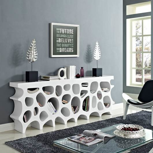 Add some whimsy to your life with modern home furnishings like the Whim Large Table or Bookshelf. Fill each uniquely shaped shelf with books, decorations, or memorabilia. Choose between white, green, or orange.