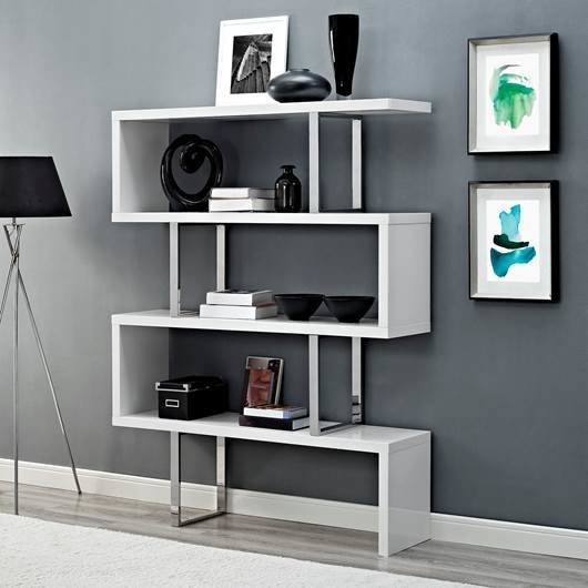 Create a minimal look on your bookshelf with modern home furnishings like the Ramble Bookshelf. The construction suggests constant movement and leads your eye from one shelf to the next. Choose between white or a walnut-grained veneer finish.