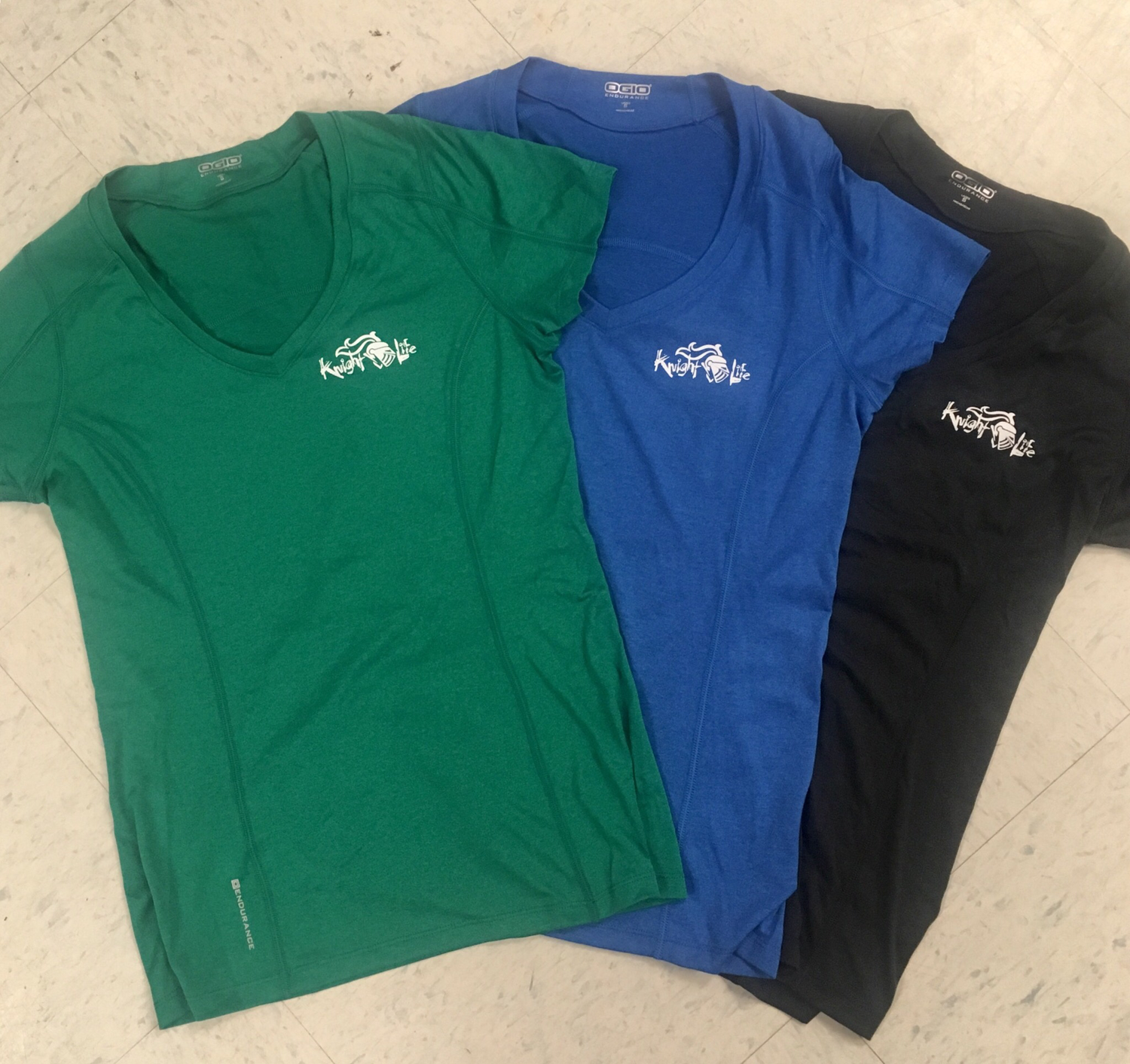 Ladies 'Ogio' Knight Life Performance V-Neck in Green, new-Steel Grey and Royal!  (black no longer available)