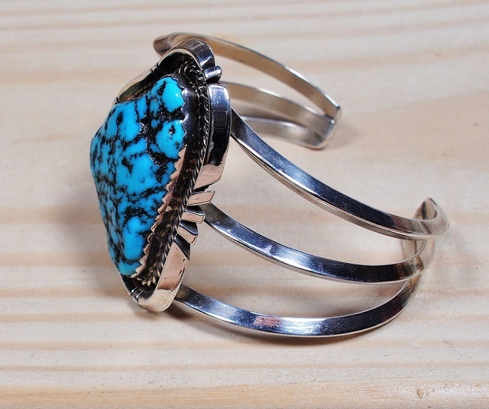 Image of the left side of the baroque cabochon cuff showing the sterling silver 3 prong cuff