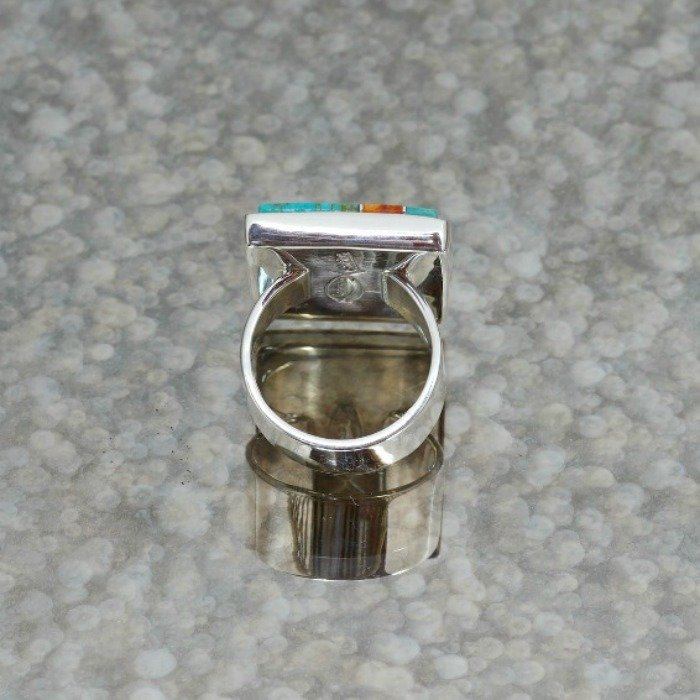 The back view of the multi-stone inlay ring showing the sterling silver backing