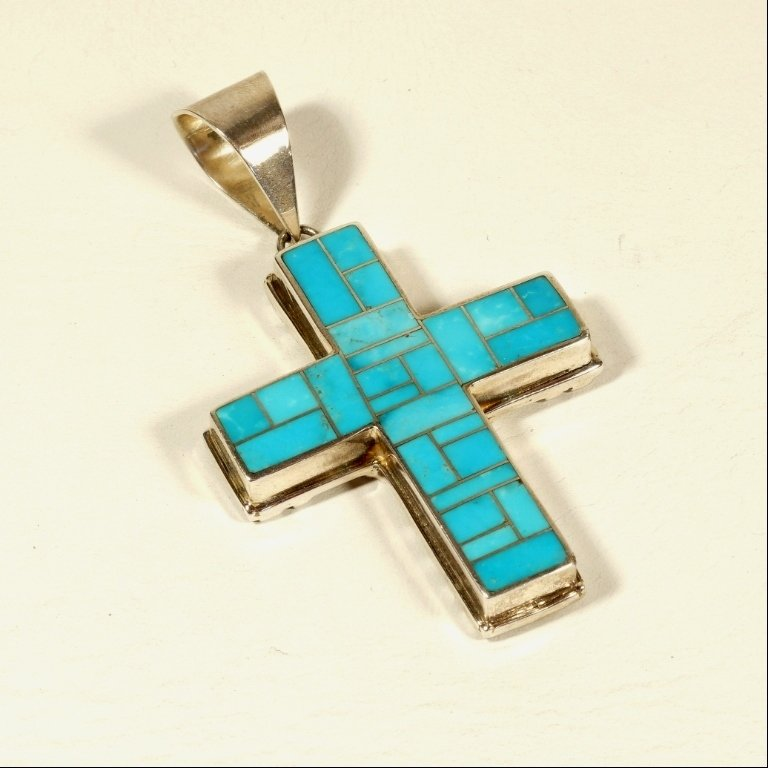 Native american two sided cross pendant on one side you have inlaid bright blue turquoise in the shape of the cross on the other side the artist has aloadofball