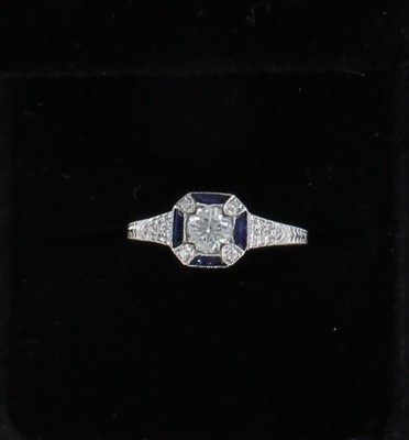 18KTW DIAMOND AND SAPPHIRE ENGAGEMENT RING