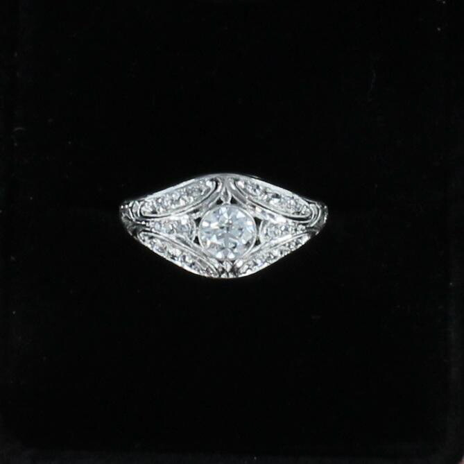 PLATINUM .55 CT ROUND DIAMOND RING, CIRCA 1930