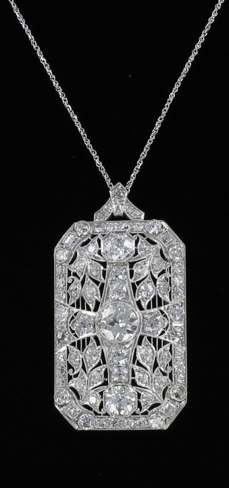 PLATINUM 7.0 CT TW DIAMOND PENDANT/PIN CIRCA 1920