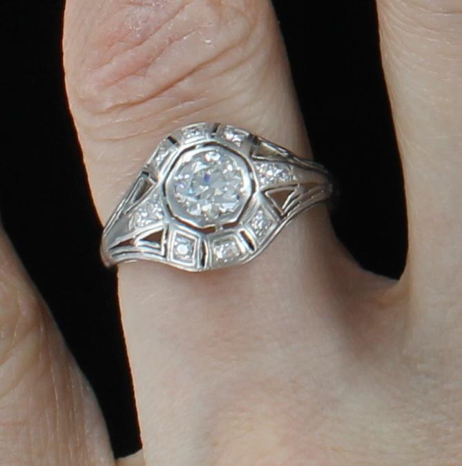 PLATINUM .65 CT OLD EUROPEAN DIAMOND ENGAGEMENT RING, CIRCA 1920