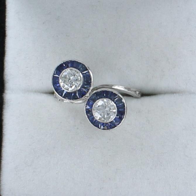 PLATINUM DIAMOND AND SAPPHIRE BYPASS RING CIRCA 1930 222-144