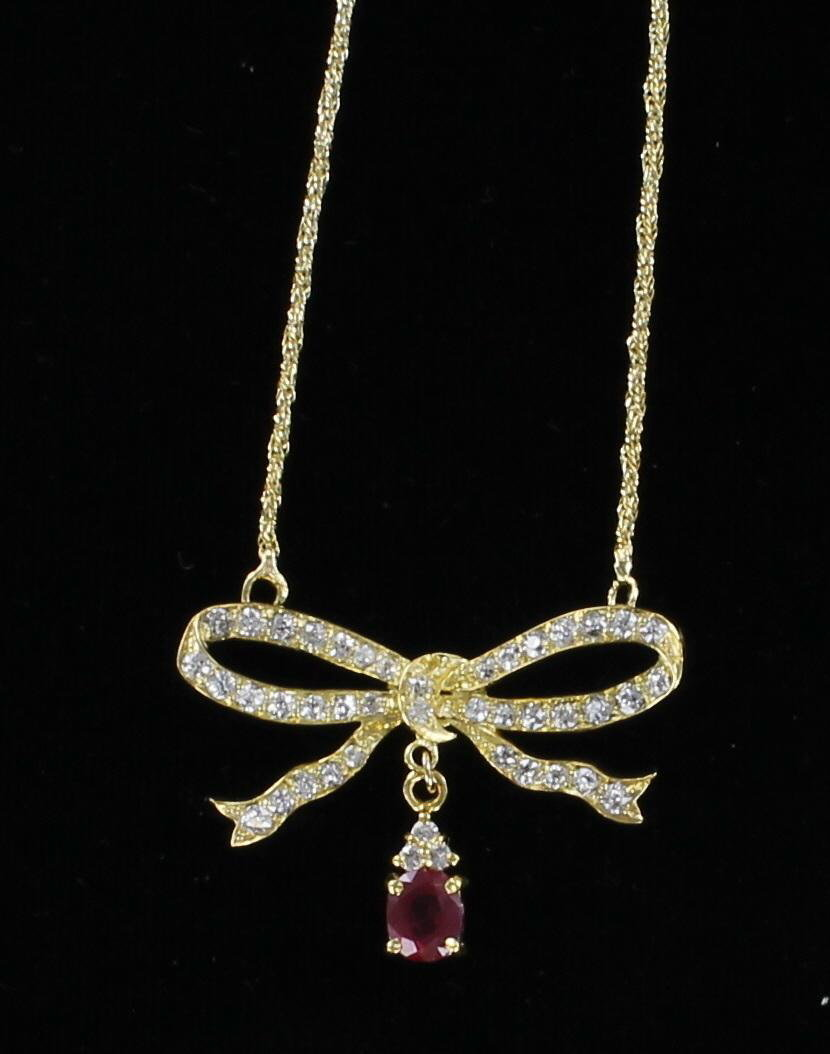 18KT DIAMOND AND RUBY BOW NECKLACE