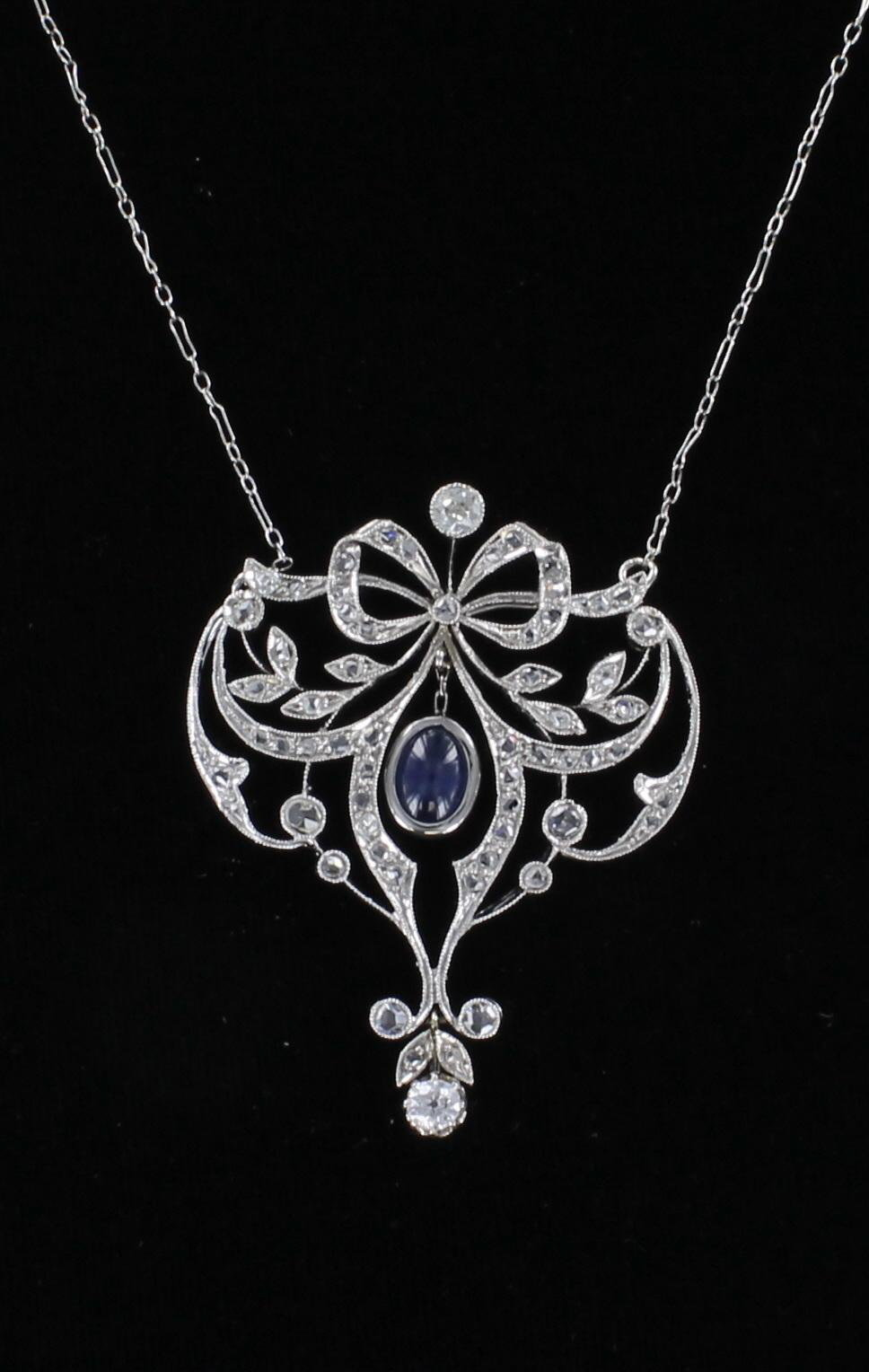 18KT SAPPHIRE AND DIAMOND BOW NECKLACE CIRCA 1920 198-23007