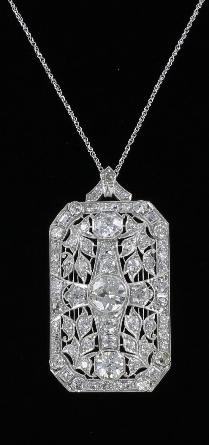 PLATINUM 7.0 CT TW DIAMOND PENDANT/PIN CIRCA 1920