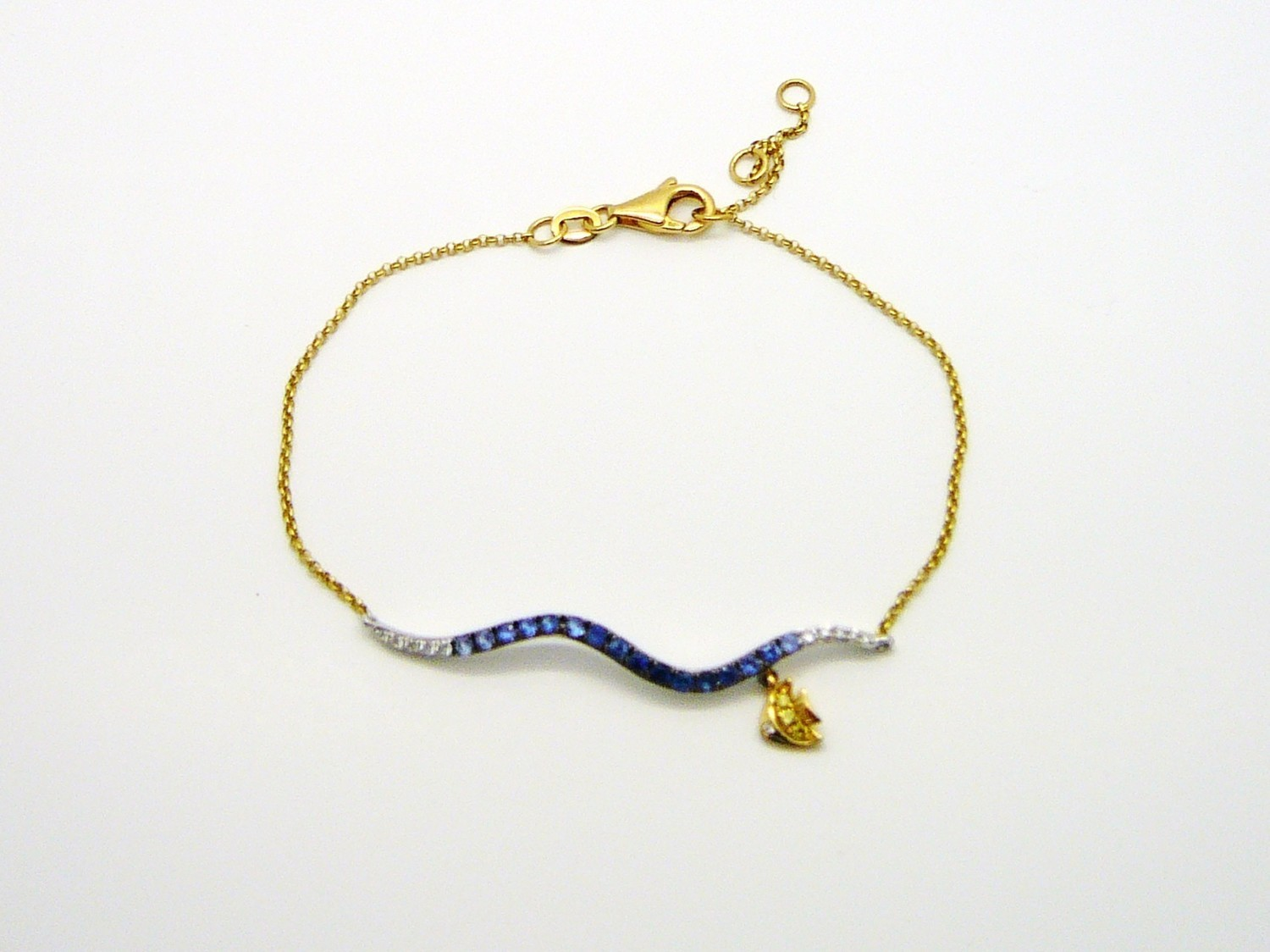 WAVE / FISH BRACELET,  14 Kt. Gold / Blue Sapp.