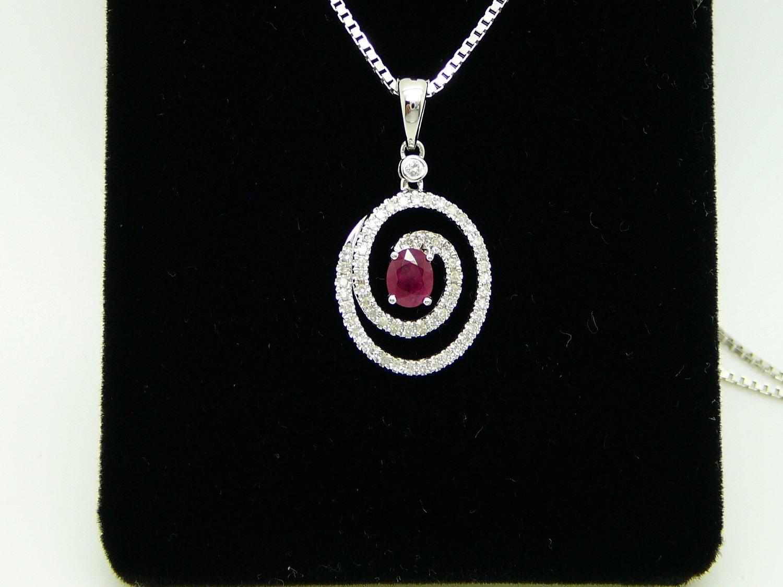 Oval Ruby Sorrounded by Pave Diamonds