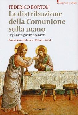 La distribuzione della comunione sulla mano