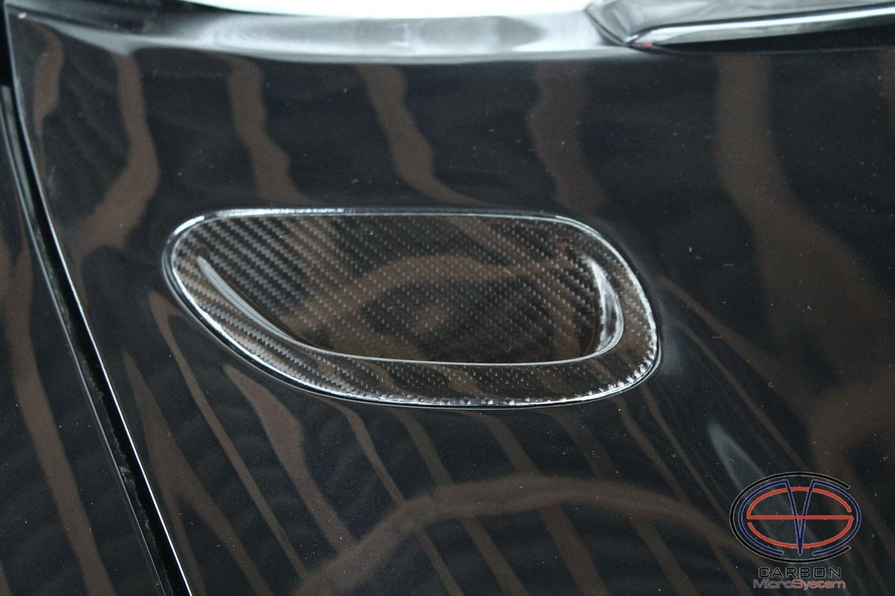 Inserts in hood from Carbon fiber