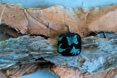 Gorgeous blue dichroic glass butterfly pendant