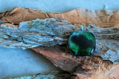 Beautiful green, blue and silver with hearts decal on a fused glass pendant.