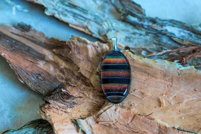 Copper, purple and silver fused glass pendant