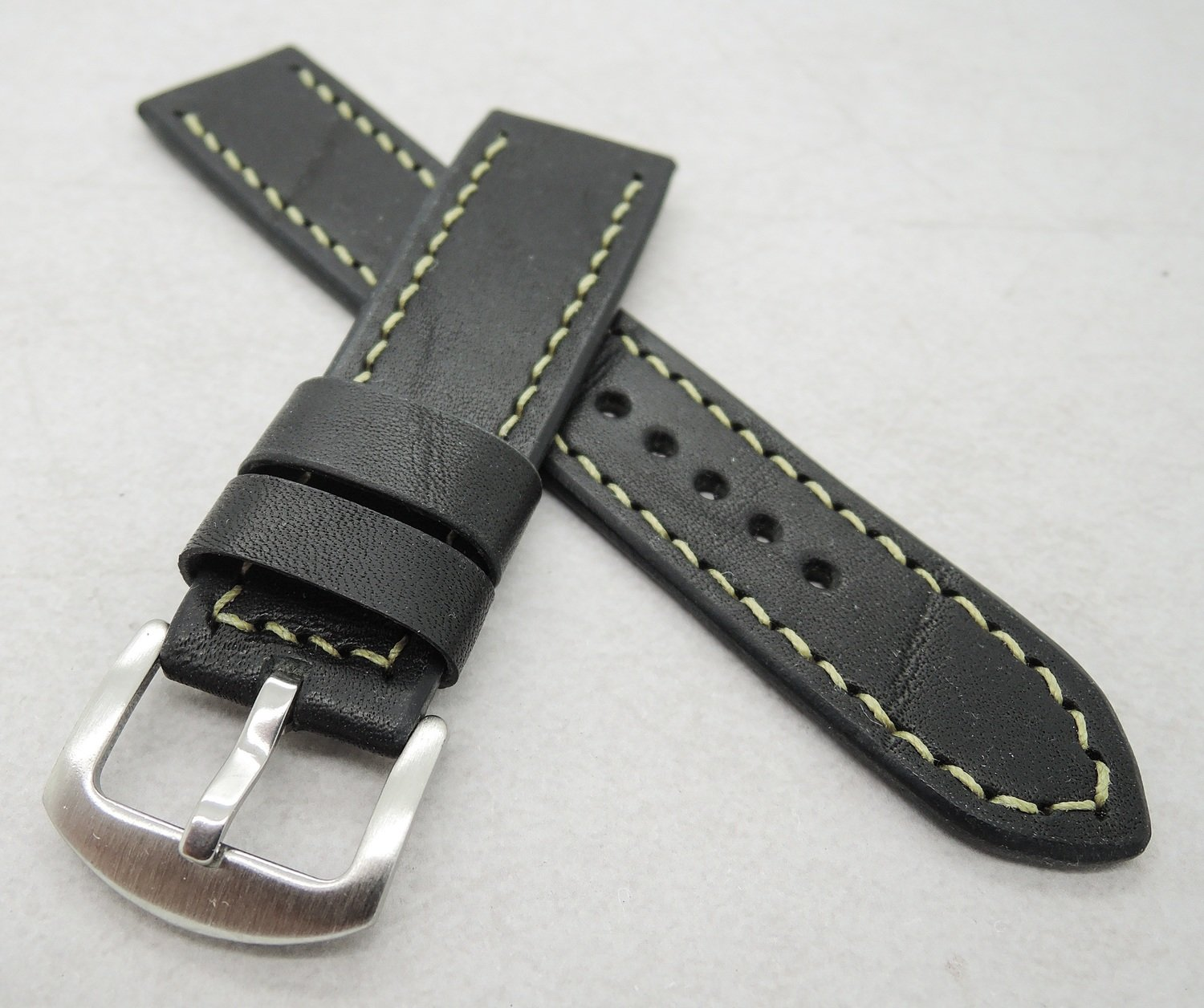 22mm wide black veg tan strap (20mm at the buckle)