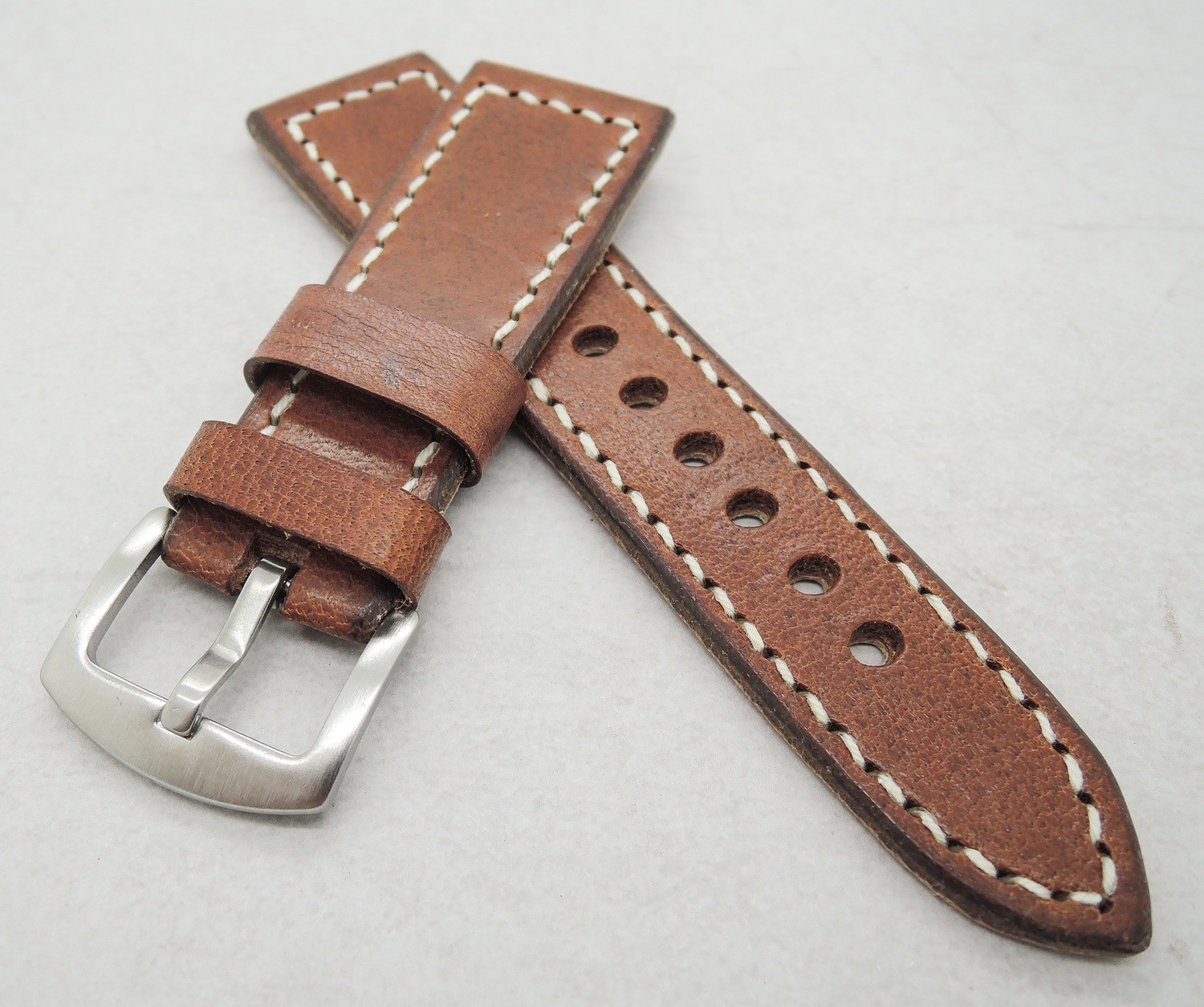 26mm wide Swiss ammo strap (22mm at the buckle)
