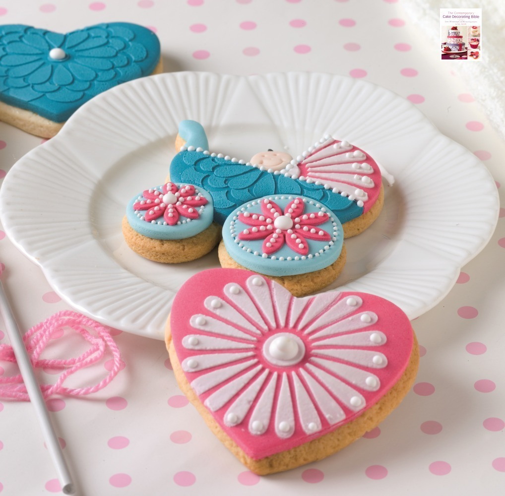 Decorated baby pram cookie from Lindy's 'Contemporary cake decorating bible' book