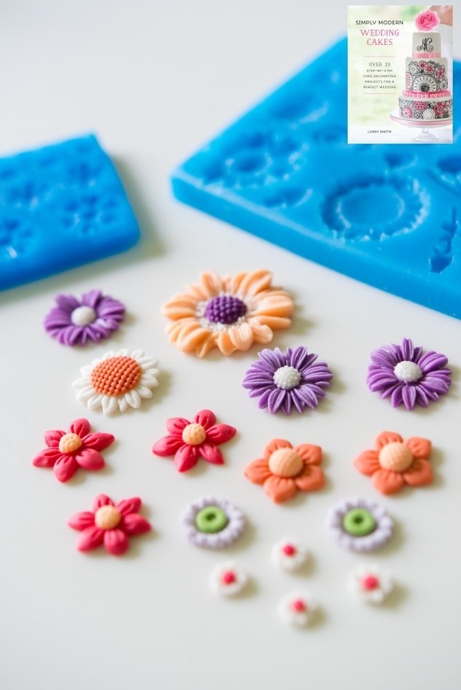 Moulded sugar flowers from the mini misc set FL107 as used in Lindy's Simply Modern Wedding Cakes' book.  Note the lilac daisies are from the small daisy set.