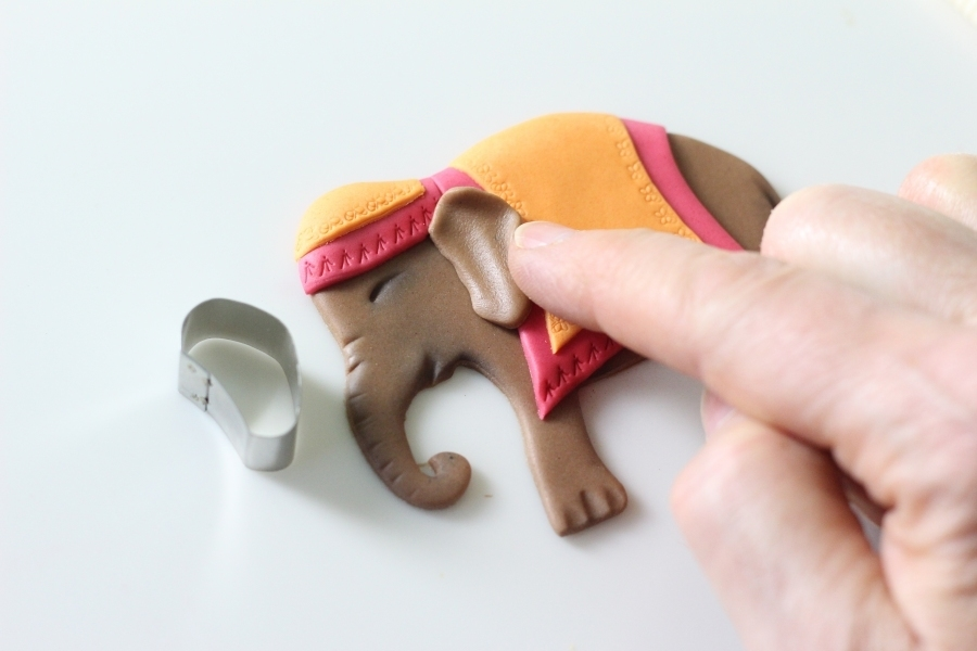 Adding an ear to the sugar elephant