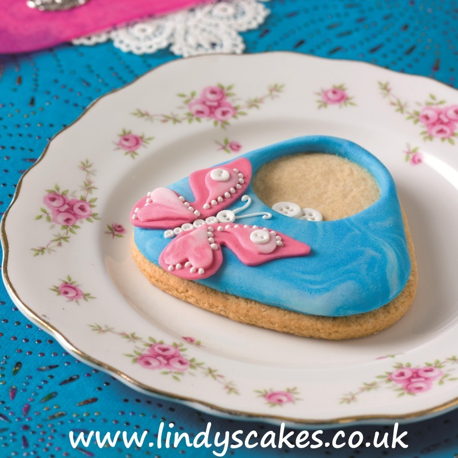 Butterfly button bag cookie from author Lindy Smith's 'Contemporary Cake Decorating Bible' book