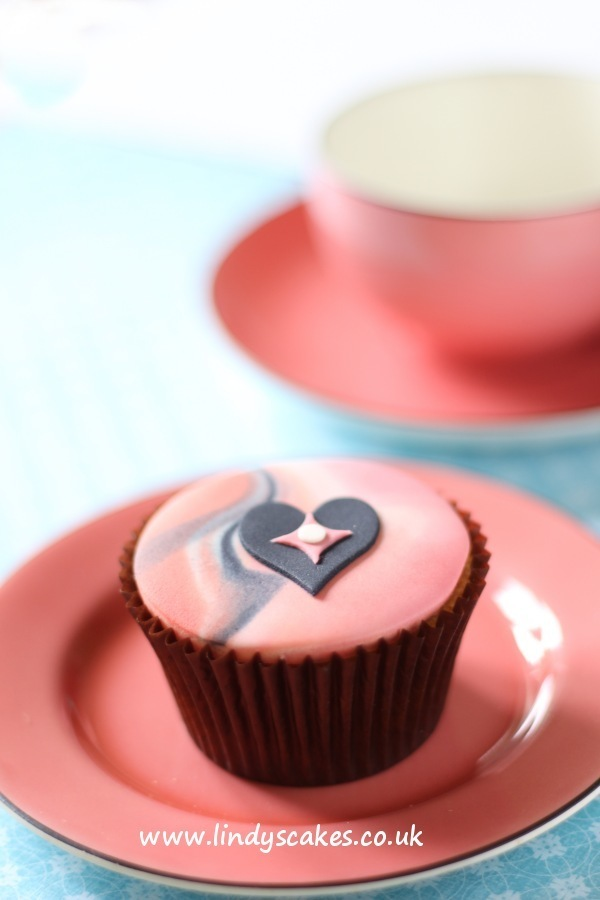 Lindy's tiny scalloped diamond was used to add interest to this decorated heart cupcake