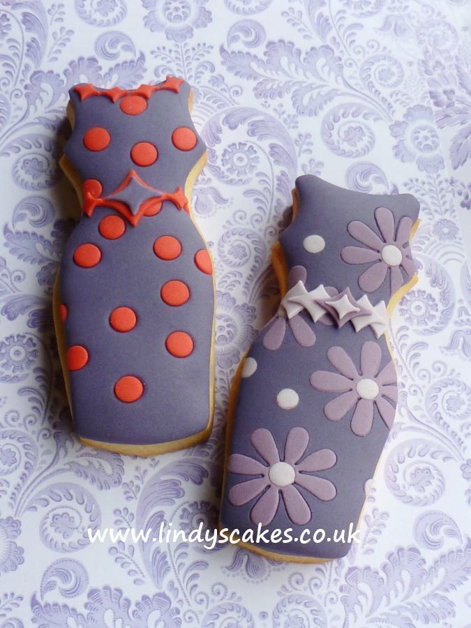 Baked and decorated fitted dress cookies. The sugar dress belts are made using Lindy's scalloped diamond sugarcraft cutter set