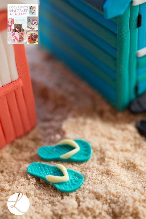 sugar flip flops help decorate and set the scene for these delightful beach hut cakes