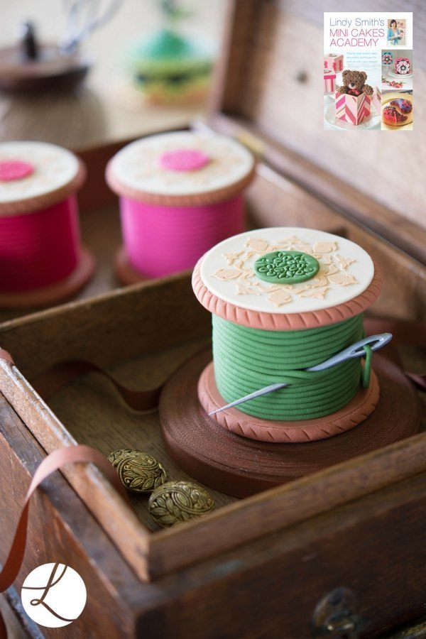 Lace motif embosser used to add interesting textured detail to the top of these delightful cotton reel cakes from 'Lindy Smith's mini cakes academy' book