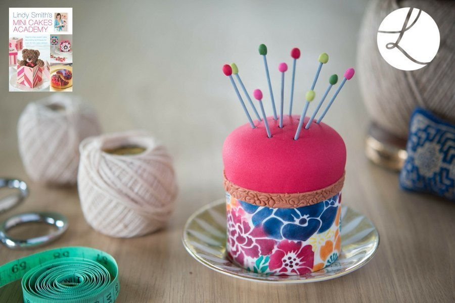 Lace motif embosser used to add interesting textured detail around the edges of this delightful pin cushion mini cake from 'Lindy Smith's mini cakes academy' book