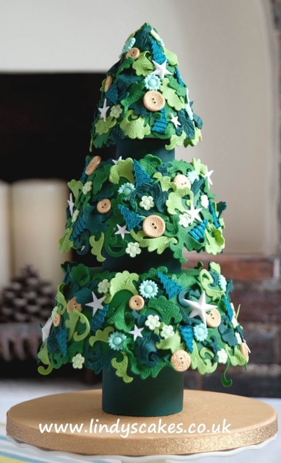 Lace embossers used to create textured detail on this Christmas tree cake from Lindy Smith 'creative colour for cake decorating' book