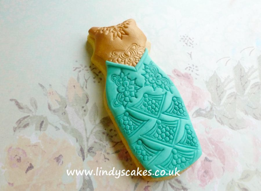 Fitted dress cookie decorated with sugarpaste textured with these lovely lace embossing stamps