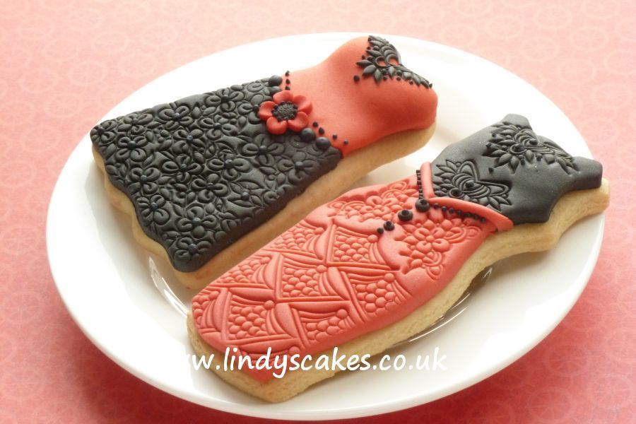 Red and black Christmas party dress cookies decorated with sugarpaste textured with these lovely lace embossing stamps