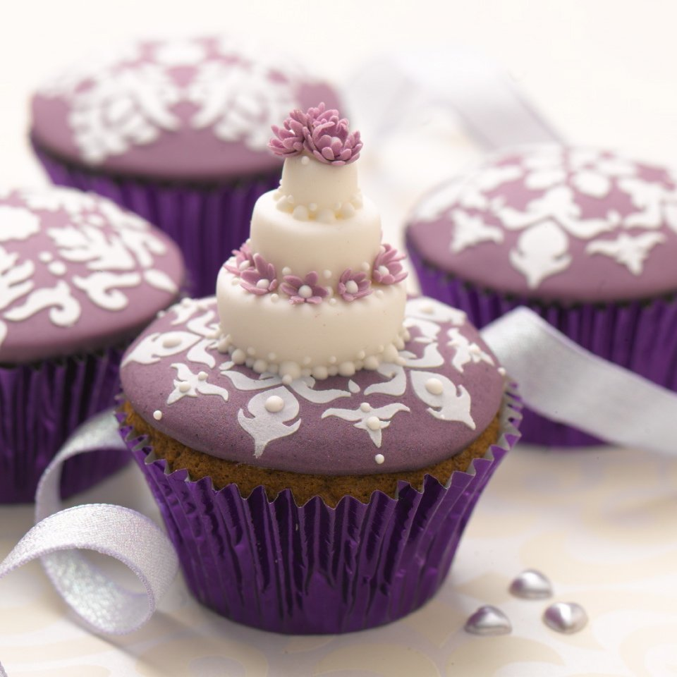 Tiered white wedding cupcake from Lindy Smith's 'bake me i'm yours ...cupcake celebration' book
