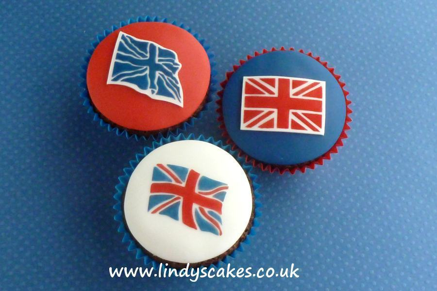 Lindy's flag cutters used with her union jack cake stencils to decorate cupcakes