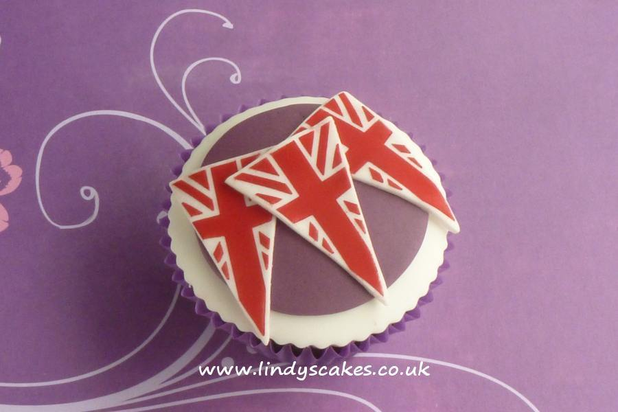 Sugarcraft bunting cutter used to decorate a simple cupcake