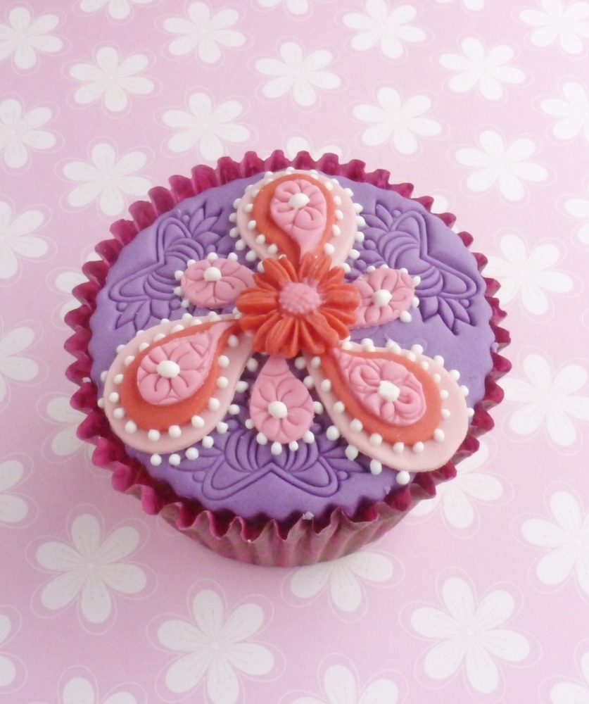 Lace motif embosser used to add texture on this paisley inspired Indian themed cupcake