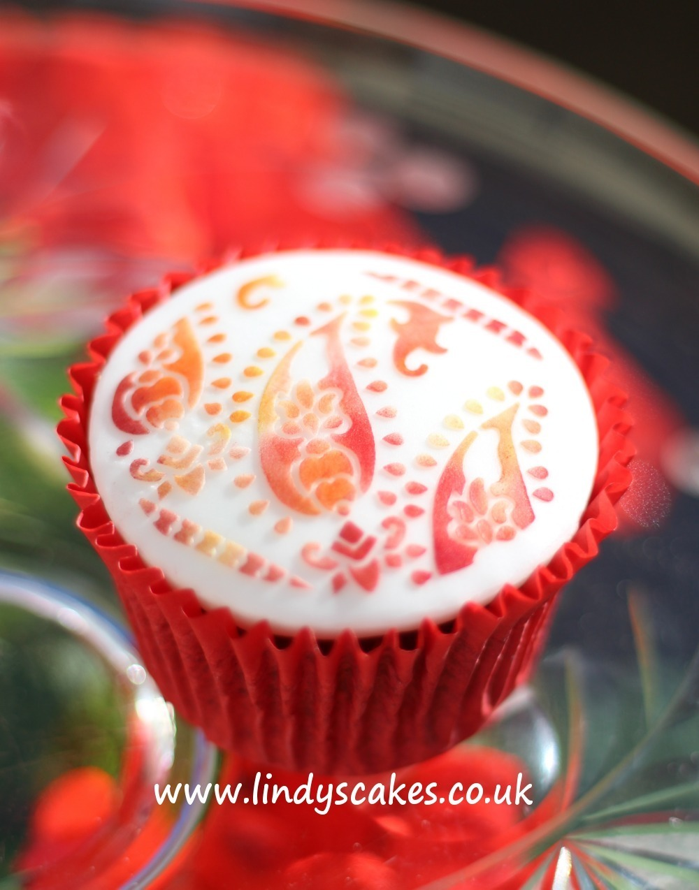 paisley cupcake stencil decorated with colourful edible dusts