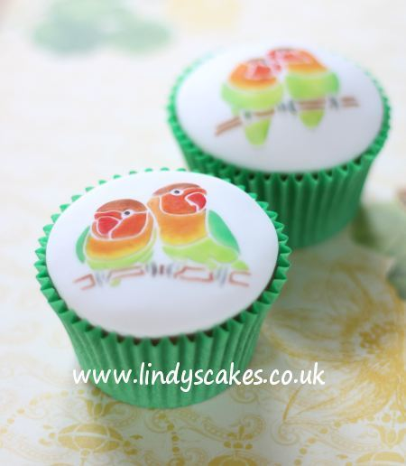 Lovebirds make a perfect cupcake top decoration, here shown in traditional colouring