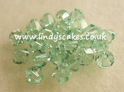 Green - pale Chrysolite Swarovski Crystals (4mm) SKU1755435