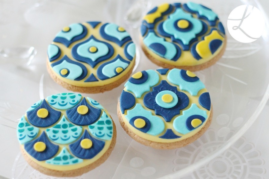 bottom right cookie is decorated using the medium arabesque sugarcraft tile cutter