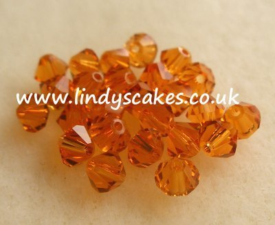 Brown - Topaz Swarovski Crystals (4mm) SKU17554131