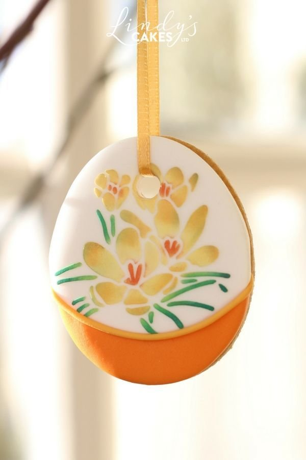 Hanging Easter eggg decorated with a crocus stencil